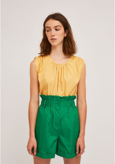 Yellow bubble hem top with...