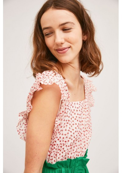 Top with armhole ruffles and red die-cut effect -  Compañía Fantástica